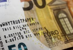 IMAGE: 50 Euro bill with bitcoin annotation
