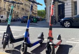 IMAGE: Scooters in a parking space